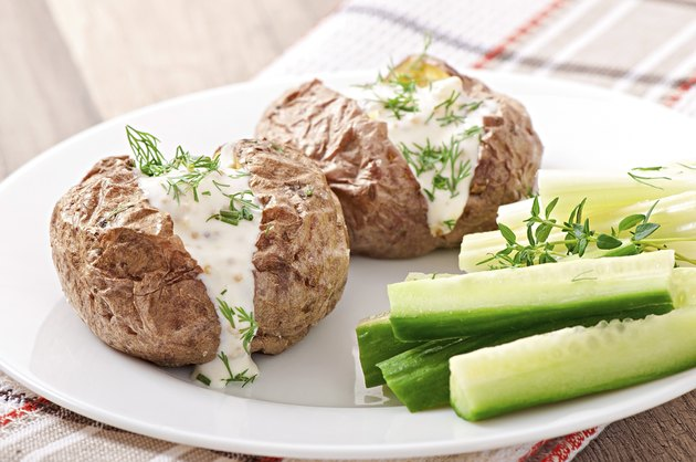 Baked potato filled with sour cream