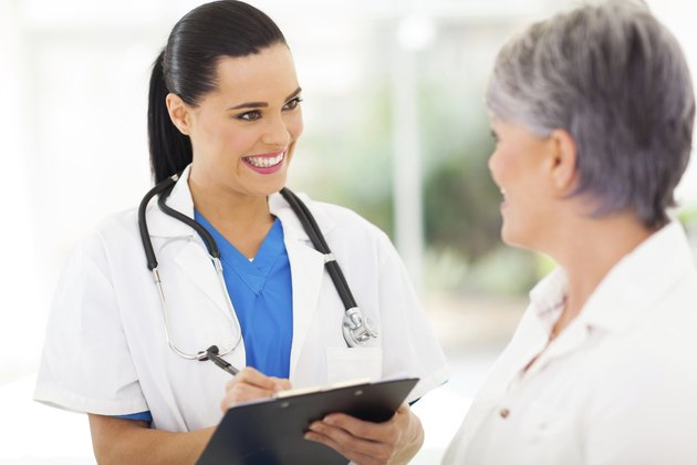 pretty young nurse talking to senior patient