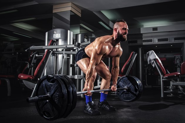 Muscular Man Doing Heavy Deadlift Exercise