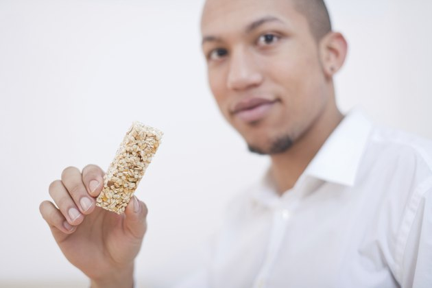 Young African-American Man Eating Cereal Bar