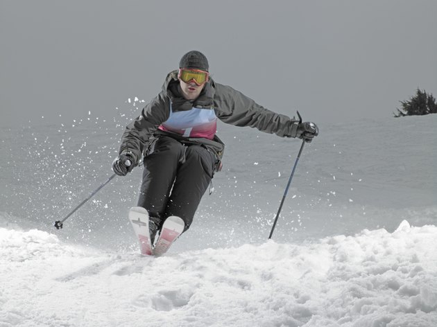Skier, skiing down slope