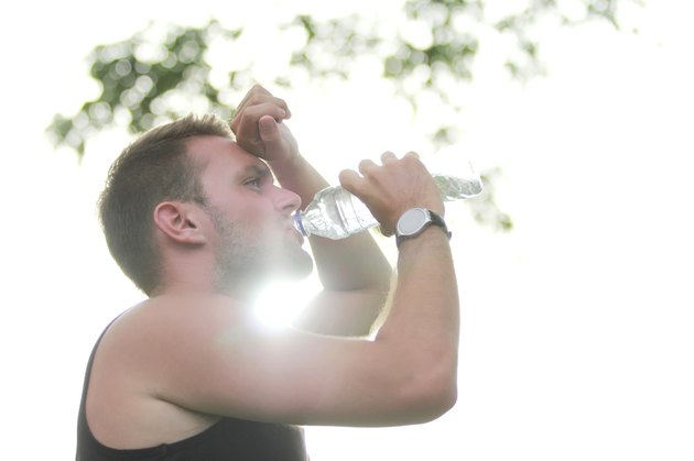 male runner drinking mineral water