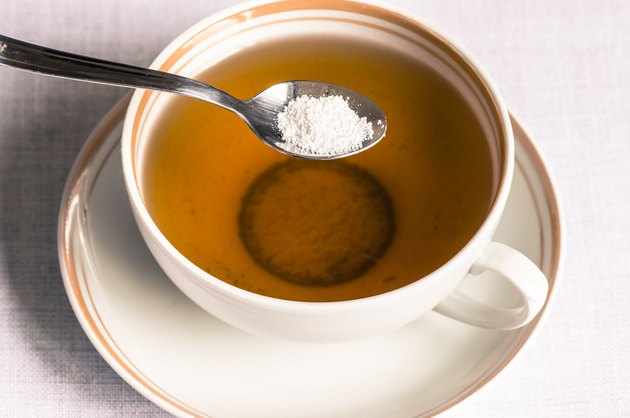 Tea with sweetener in a spoon