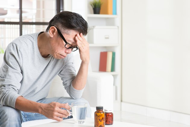 Mature Asian Chinese man headache