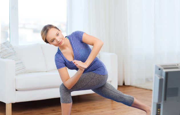 woman making yoga low angle lunge pose on mat