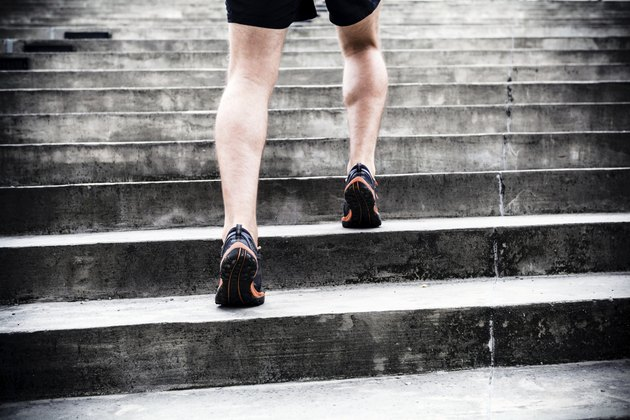 Jogger running on stairs, sports training