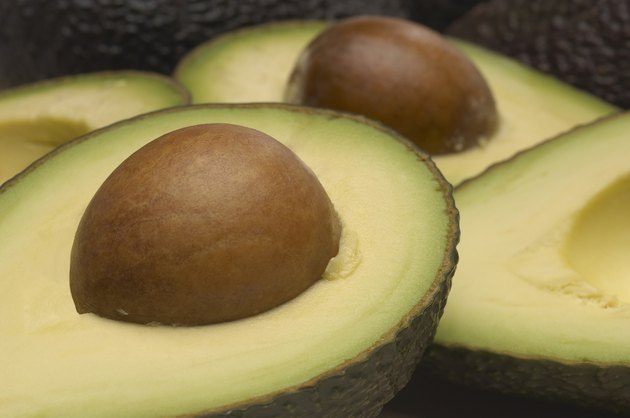 Studio shot of halved avocados