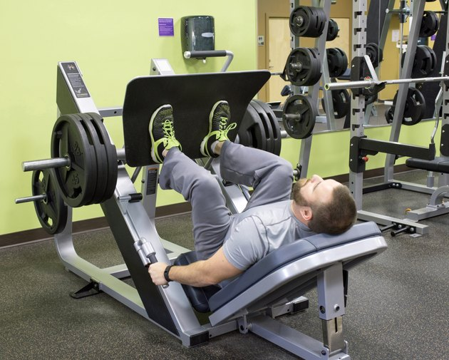 Man Using Plate Loaded Leg Press