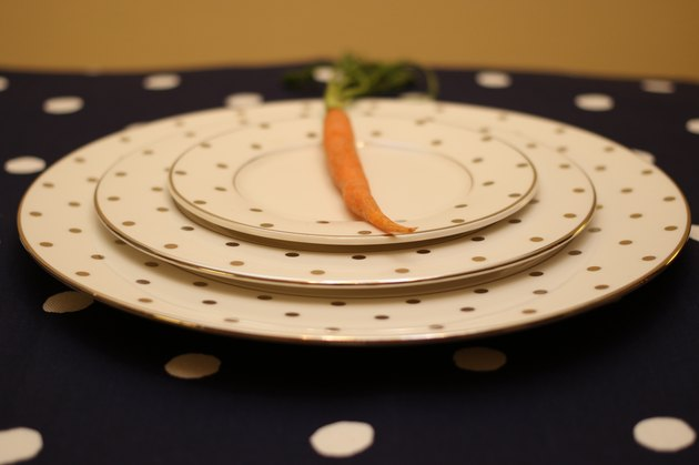 Food: empty plate setting with carrot