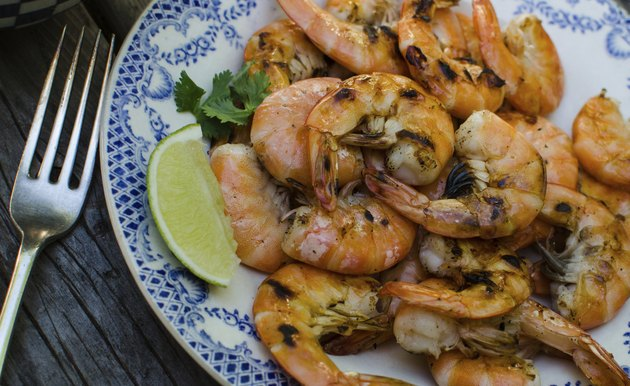 Freshly grilled shrimp on a plate with lime slice