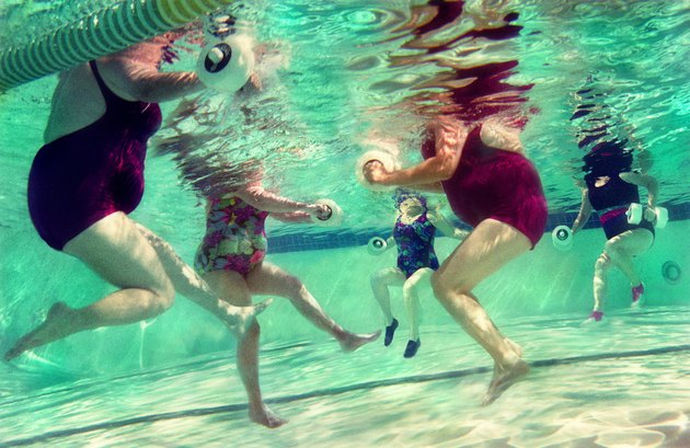 Mature women doing aqua aerobics, uderwater view (Digital Composite)