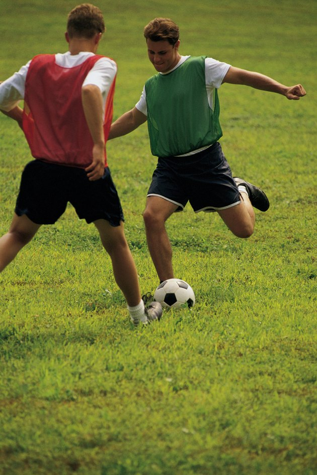 Teenage boys playing soccer
