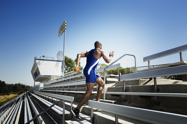 Athletic man running up bleachers