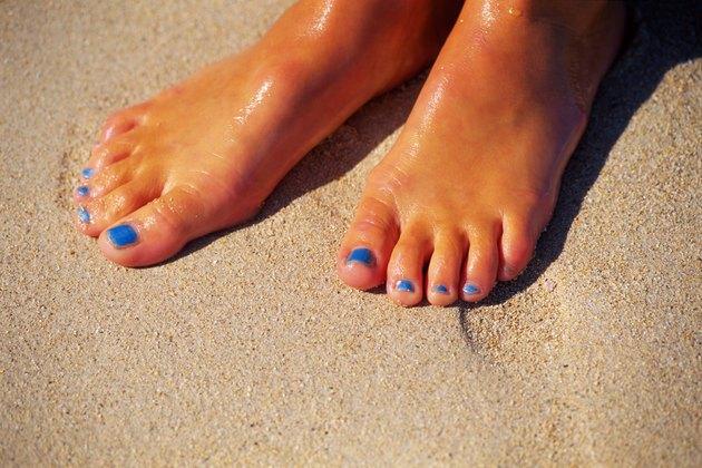 Woman's feet in sand
