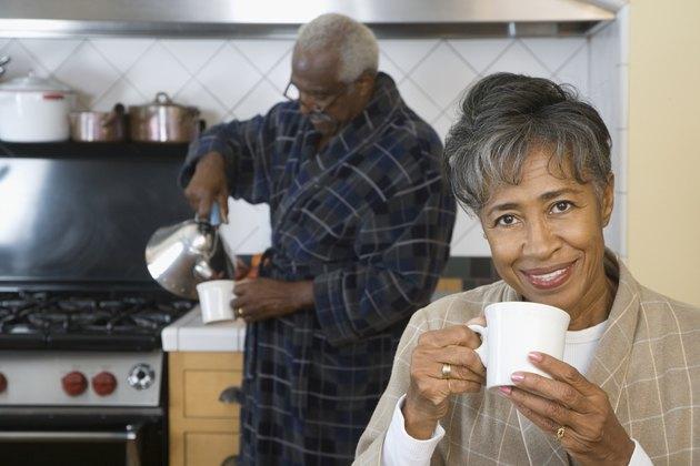 Senior African couple drinking coffee