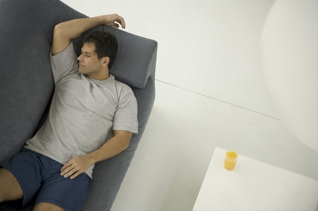 Mature man sleeping on couch