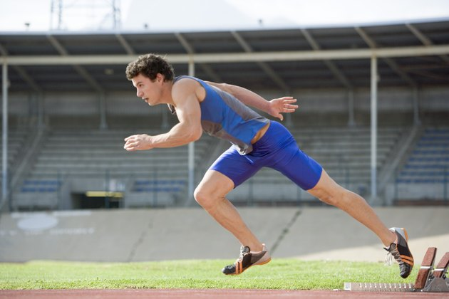 Athlete running on track