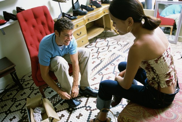 Young couple sitting in a shoe store
