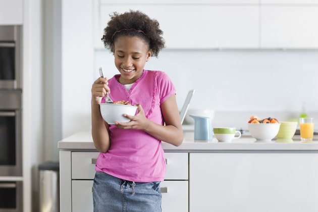 Girl Eating Cereal for Breakfast