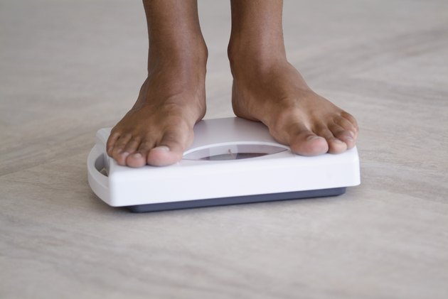 Person standing on a weighing scale