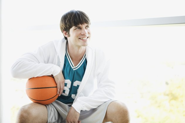 Seated basketball player looking away