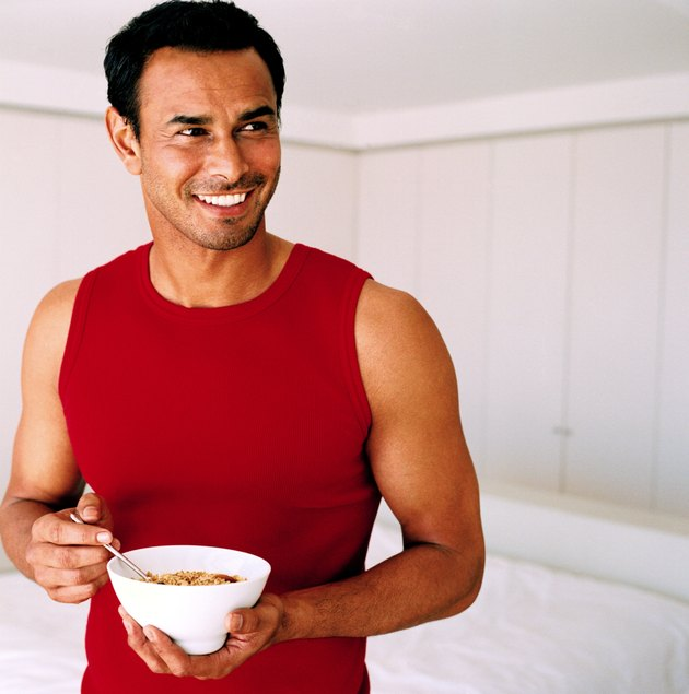 Young man holding a bowl of cereal