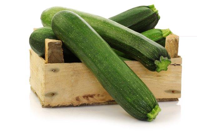 fresh zucchini's in a wooden box