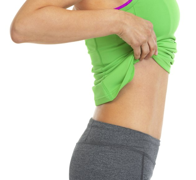 closeup on fitness woman showing flat belly