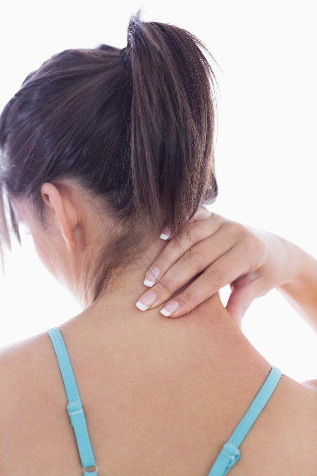 Rear view of young woman with neck pain