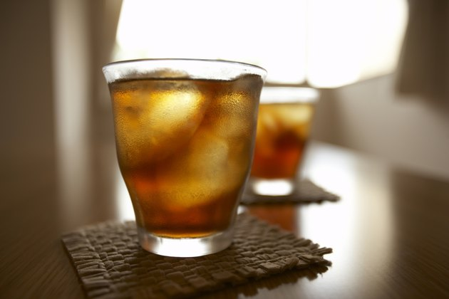 Glasses of iced tea on table, close up, differential focus