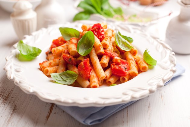 Sedani rigati pasta with cherry tomatoes and basil