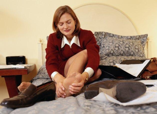Businesswoman Massaging Feet