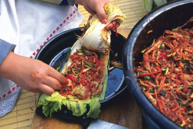 Closed Up Image of a Person Making Kimchi With Some Lettuce, High Angle View