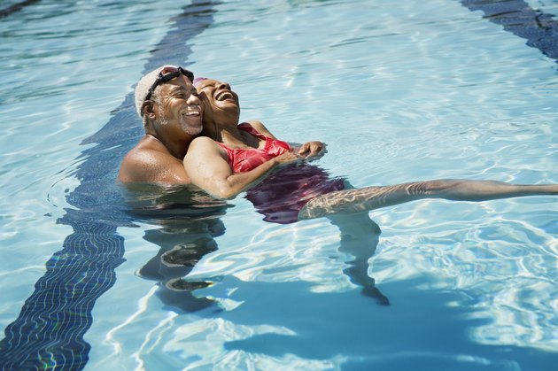 Senior couple embracing in pool