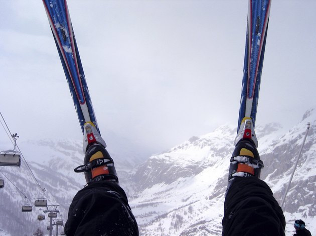 Skis over foggy Alps