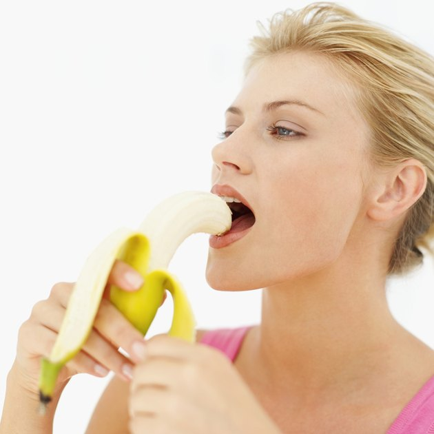 Young woman eating a banana