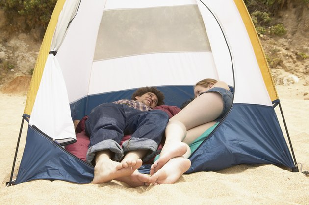 Teenage couple lying in a tent