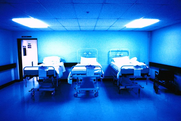 interior of a hospital recovery room with three beds