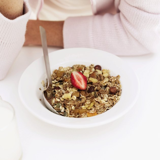 Woman in front of a bowl of breakfast cereal