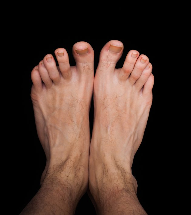 Pair of caucasian male feet isolated