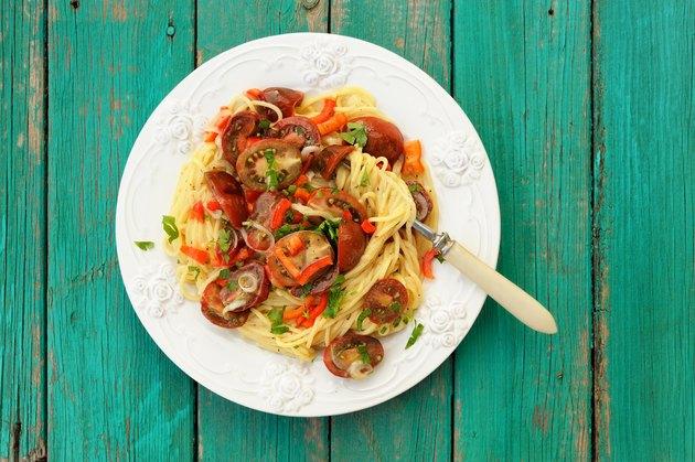 Spaghetti al Pomodoro in white plate with fork
