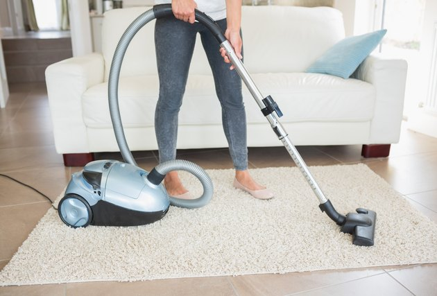 Woman hovering rug
