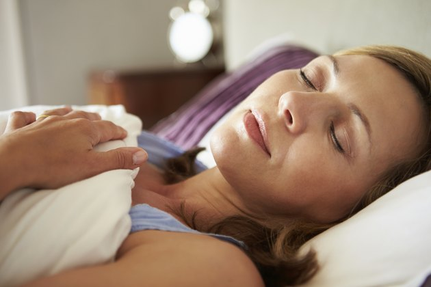 Attractive Middle Aged Woman Asleep In Bed