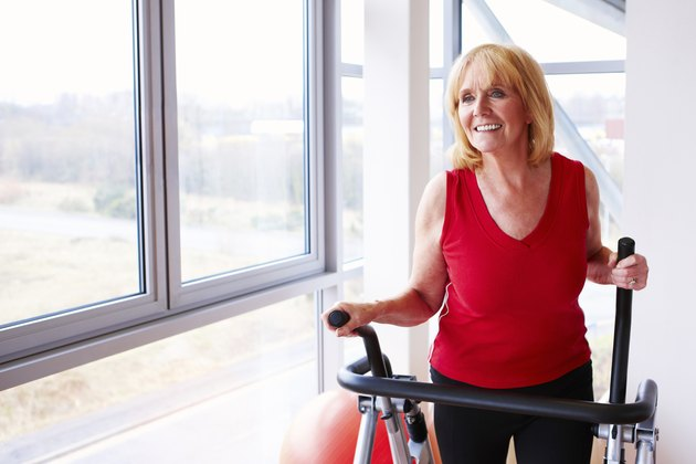 Mature Woman Using an Elliptical Machine