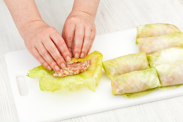 chef prepares stuffed cabbage rolls