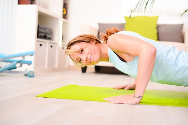 attractive and healthy lifestyle young woman doing fitness exercises and workout at home