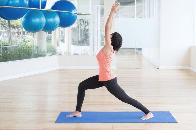 Asian woman make yoga Warrior pose