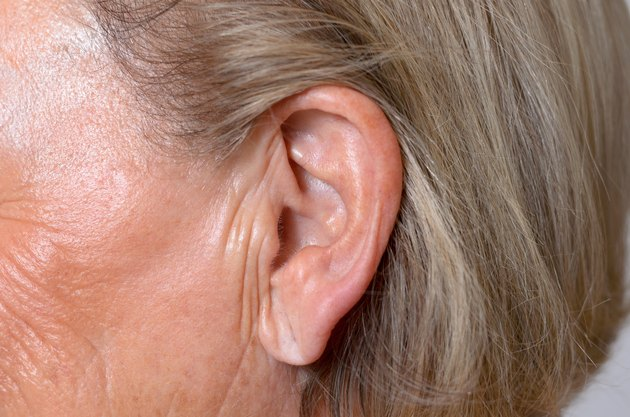 Close up of the ear of an elderly woman