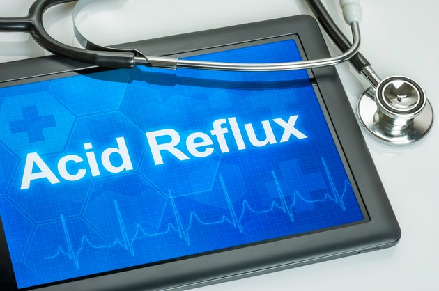 Tablet with the diagnosis Acid Reflux on the display