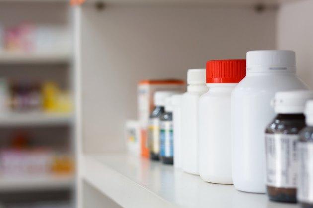 bottles on pharmacy store shelf